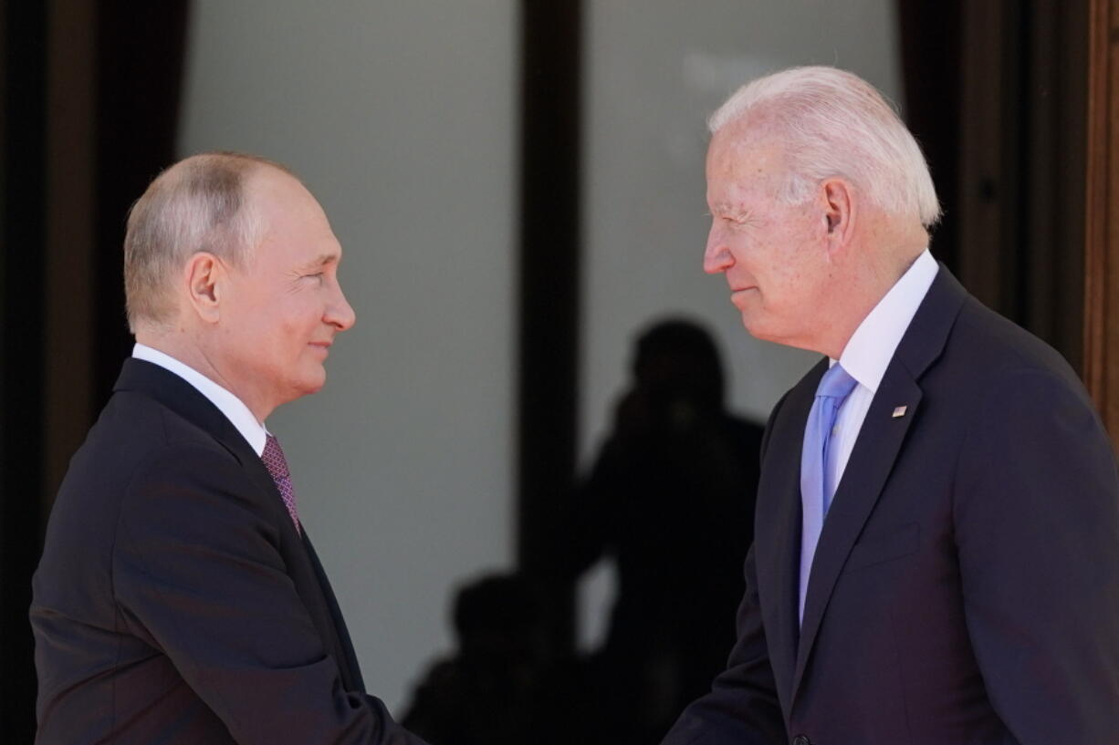 """FILE - In this June 16, 2021 file photo, President Joe Biden and Russian President Vladimir Putin, arrive to meet at the 'Villa la Grange',  in Geneva, Switzerland. In their search for a new approach to arms control, Moscow and Washington are likely to soon encounter an old bugaboo: Russia's demand that the U.S. stop resisting limits on its missile defenses, which the Russians view as a long-term threat and the Americans see as a deterrent to war. It is likely to arise when U.S. and Russian officials open a """"strategic stability"""" dialogue Wednesday in Geneva -- talks meant to lay the groundwork for future arms control and to reduce the risk of nuclear war."""