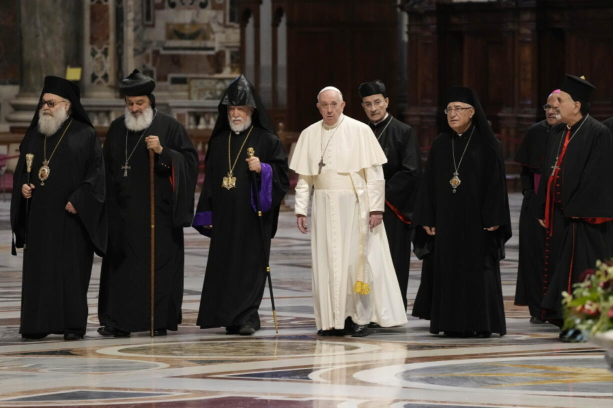 The Patriarch of the Syriac Orthodox Church, Moran Mor Ignatius Aphrem II, second from left, the head of the Catholicosate of the Great House of Cilicia of the Armenian Apostolic Church, Aram I, third from left, Pope Francis, fourth from left, Cardinal Bechara Boutros al-Rahi, firfth from left, Patriarch of Antioch and All the East for the Syriac Catholic Church, Ignatius Youssef III Younan, right, arrive in St. Peter's Basilica to attend a prayer for Lebanon at the Vatican, Thursday, July 1, 2021.