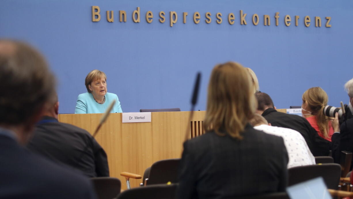 German Chancellor Angela Merkel speaks, during her annual summer news conference in Berlin, Germany, Thursday, July 22, 2021.  Merkel said Thursday that new coronavirus infections in Germany are once again rising at worrying speed. She appealed to her compatriots to get vaccinated and persuade others to do so.