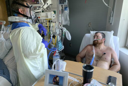 Registered Nurse Chris Murphy walks 31-year-old Daryl Barker through breathing techniques inside Lake Regional Hospital's Intensive Care Unit on Monday, July 26, 2021, in Osage Beach, Mo. Murphy, an Army veteran who served as a Combat Medic in Iraq often leans on the resiliency he learned in the military to fight off mental fatigue.