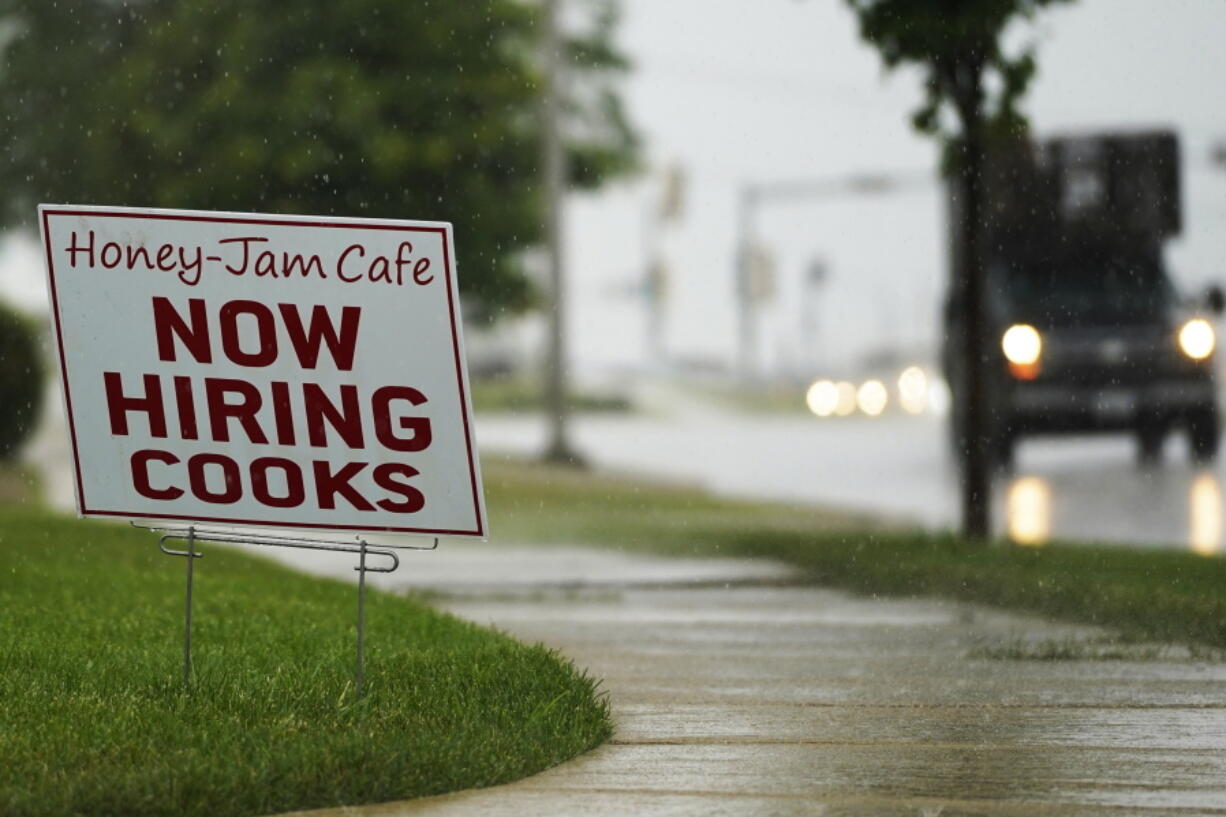 A hiring sign is shown in Downers Grove, Ill., Thursday, June 24, 2021. The number of Americans collecting unemployment benefits slid last week, another sign that the job market continues to recover rapidly from the coronavirus recession.