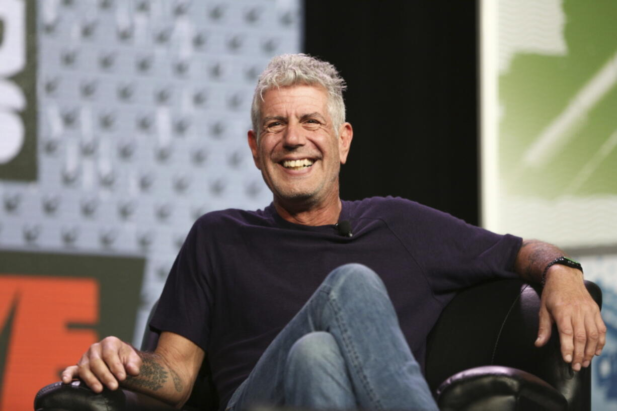 """FILE - In this Sunday, March 13, 2016, file photo Anthony Bourdain speaks during South By Southwest at the Austin Convention Center, in Austin, Texas. The revelation that a documentary filmmaker used voice-cloning software to make the late chef Bourdain say words he never spoke has drawn criticism amid ethical concerns about use of the powerful technology. The movie """"Roadrunner: A Film About Anthony Bourdain"""" appeared in cinemas Friday, July 16, 2021, and mostly features real footage of the beloved celebrity chef and globe-trotting television host before he died in 2018."""