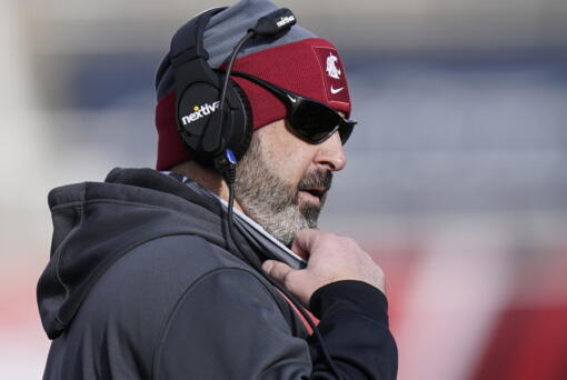 FILE - Washington State head coach Nick Rolovich looks on during the first half of an NCAA college football game against Utah in Salt Lake City, in this Saturday, Dec. 19, 2020, file photo. Rolovich has become the story of Pac-12 media day even though he won't be in attendance. Rolovich's announcement last week he has chosen not to receive a COVID-19 vaccination has divided his fan base and seemingly his school as one of the colleges requiring students and staff to be vaccinated before the start of classes this fall.