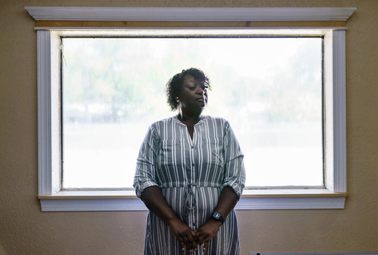 """Latonya Crowley, mother of Warren Williams, stands for a portrait in Palatka, Fla., Thursday, April 22, 2021. An FBI probe revealed a murder plot against her son by klansmen working as prison guards where Williams was once an inmate. """"In the state of mind that he's in today. I don't see him getting better,"""" Crowley says, as she and her son live today with uncertainty and paranoia. One of the guards' imminent release and the specter of other klansmen have made it impossible for Williams to move on."""