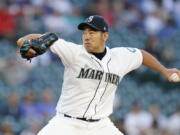 Seattle Mariners starting pitcher Yusei Kikuchi throws to a New York Yankees batter during the second inning of a baseball game Wednesday, July 7, 2021, in Seattle.