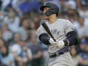 New York Yankees starting pitcher Jameson Taillon throws to a Seattle Mariners batter during the seventh inning of a baseball game Tuesday, July 6, 2021, in Seattle. (AP Photo/Ted S.