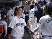Seattle Mariners starting pitcher Logan Gilbert is congratulated by J.P. Crawford (3) after throwing against the New York Yankees through seven innings of a baseball game Thursday, July 8, 2021, in Seattle.