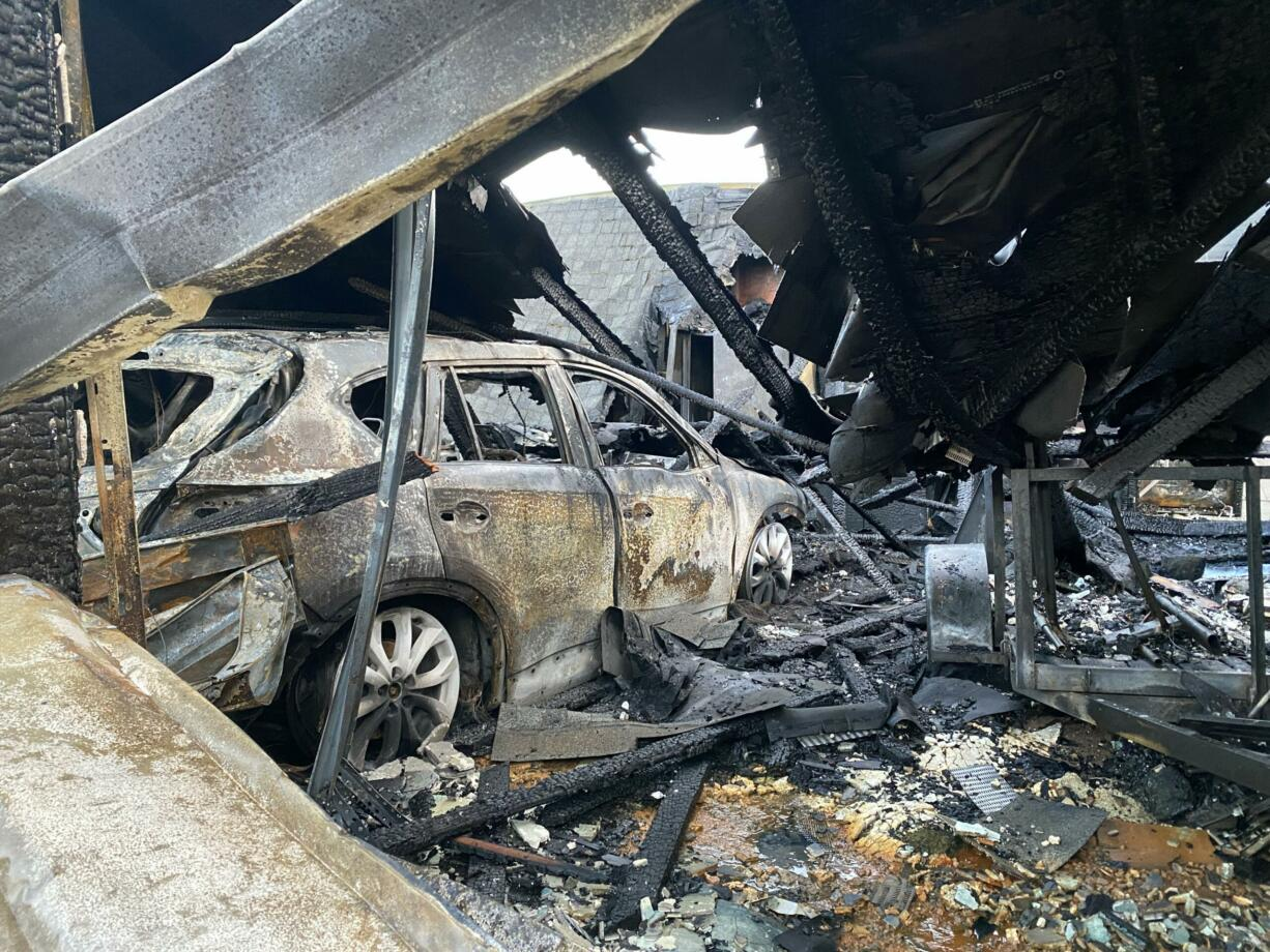 After a two alarm fire at a home in Camas, the garage and its contents were a total loss.