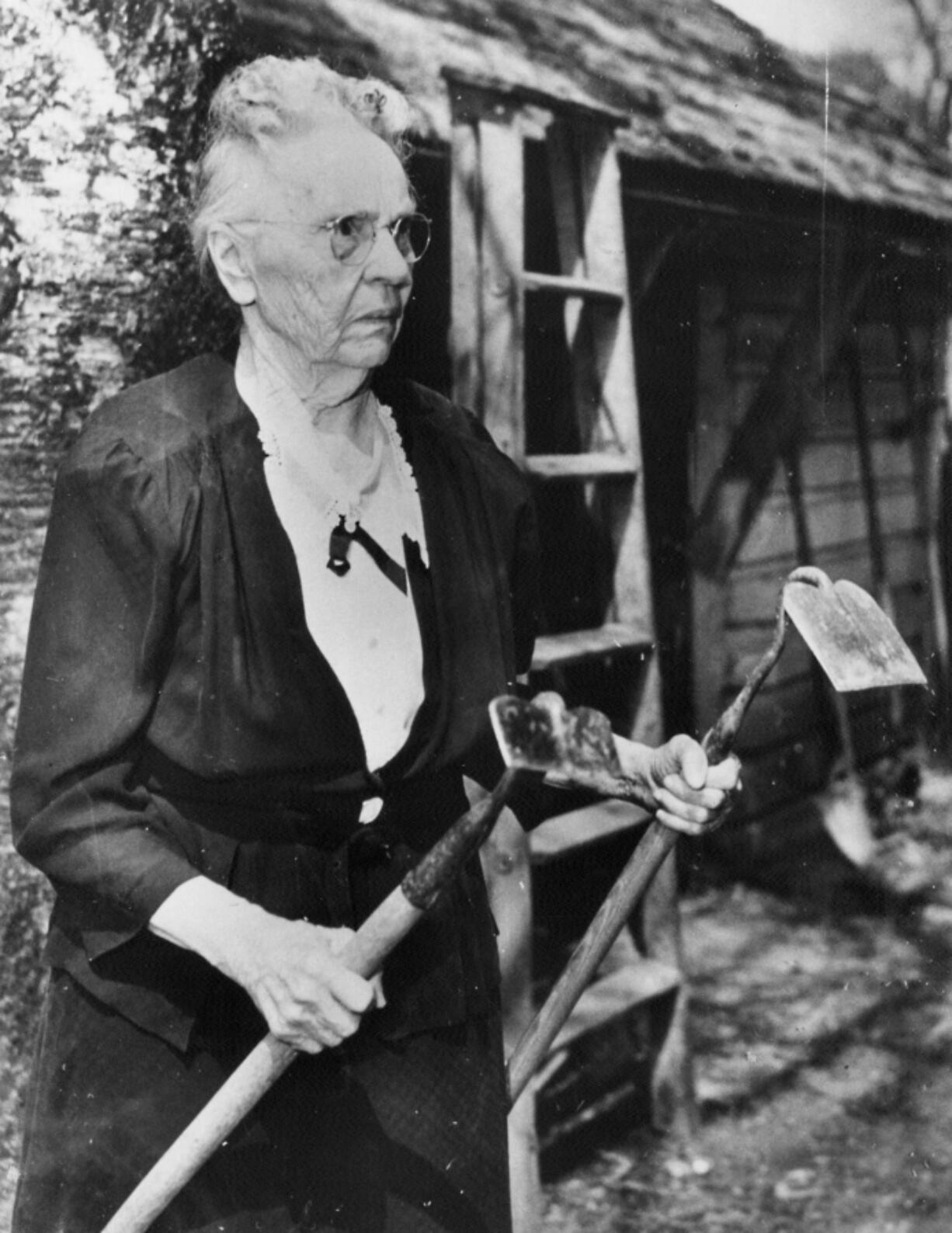 Hulda Klager, pictured in the in 1940s or '50s, started hybridizing apples in 1905 to have better ones for her pies. By 1922, she was a lilac phenomenon. Thousands of people traveled to her Woodland home each year to talk with her and learn about botanical techniques. When her husband, Frank, died in 1928, she almost abandoned her lilac work. Her son encouraged her to keep going.