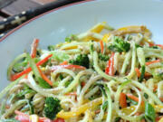 A zucchini noodle salad with an East Asian-inspired tahini-ginger dressing is an easy, low-carb summer dish.