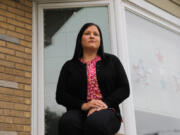 Estella Valdez, seen at her home in Chicago on July 22, has an international trip to Aruba in August and is the only person in her bridal party who still needs a passport. (Jose M.
