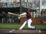Ridgefield's Brady Kasper takes a swing in a West Coast League baseball game at Ridgefield Outdoor Recreation Complex on Wednesday, August 4, 2021.