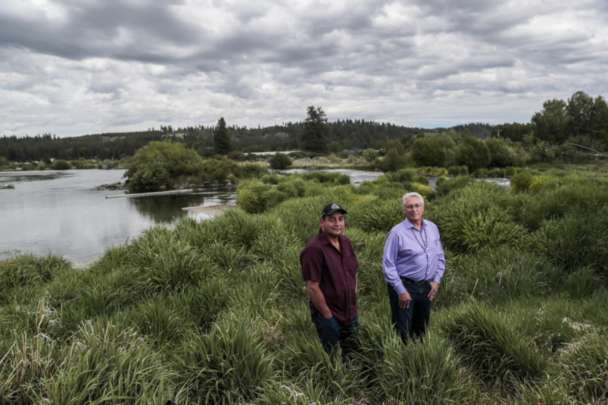 Council member Clayton Dumont, left, and tribal Chairman Don Gentry stand next to the Sprague River, which flows to Upper Klamath Lake.