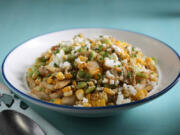 Corn and edamame succotash salad, toped with quest fresco, prepared and style by Shannon Kinsella.