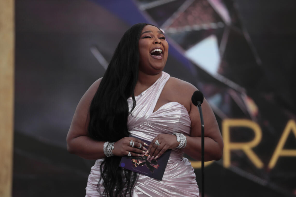 Lizzo presents Best New Artist on stage at the 63rd Grammy Awards outside Staples Center in Los Angeles on Sunday, March 14, 2021.
