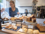 Jessica Gipe arranges pasteries at the Bleu Door Bakery in Vancouver in 2015.