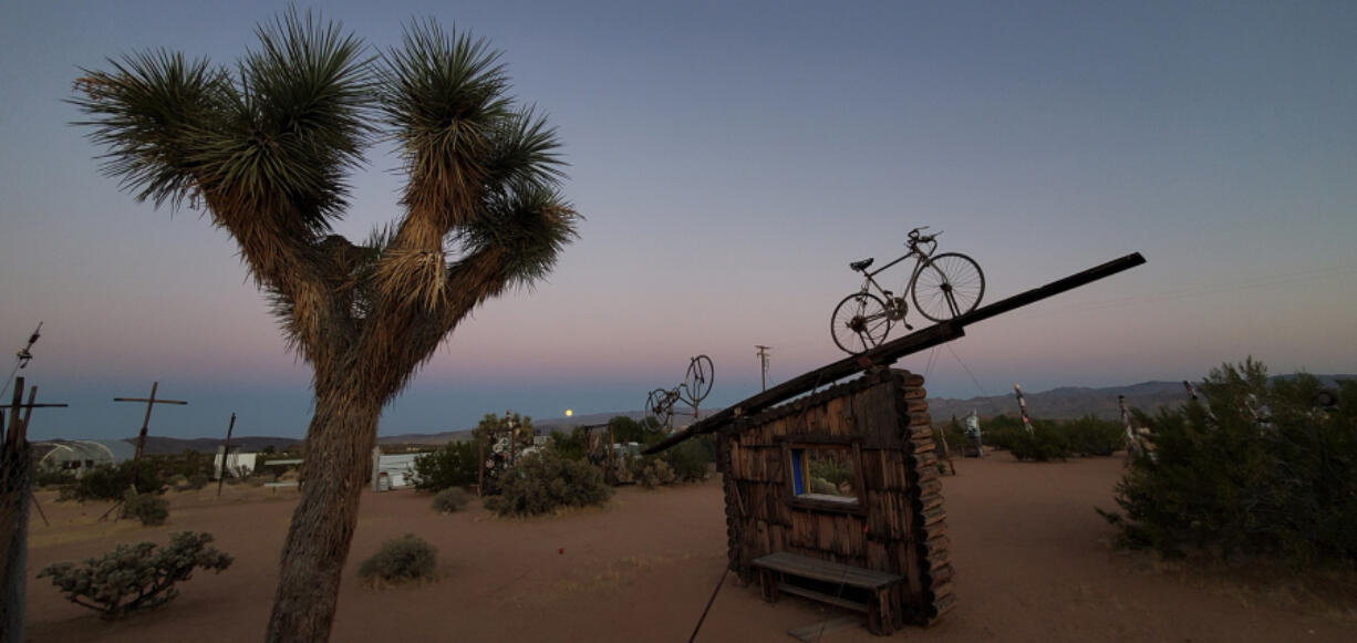 A bicycle appears ready to ride into the sunset at the Noah Purifoy Desert Art Museum of Assemblage Art, a 10-acre installation the late L.A. artist created in Joshua Tree.