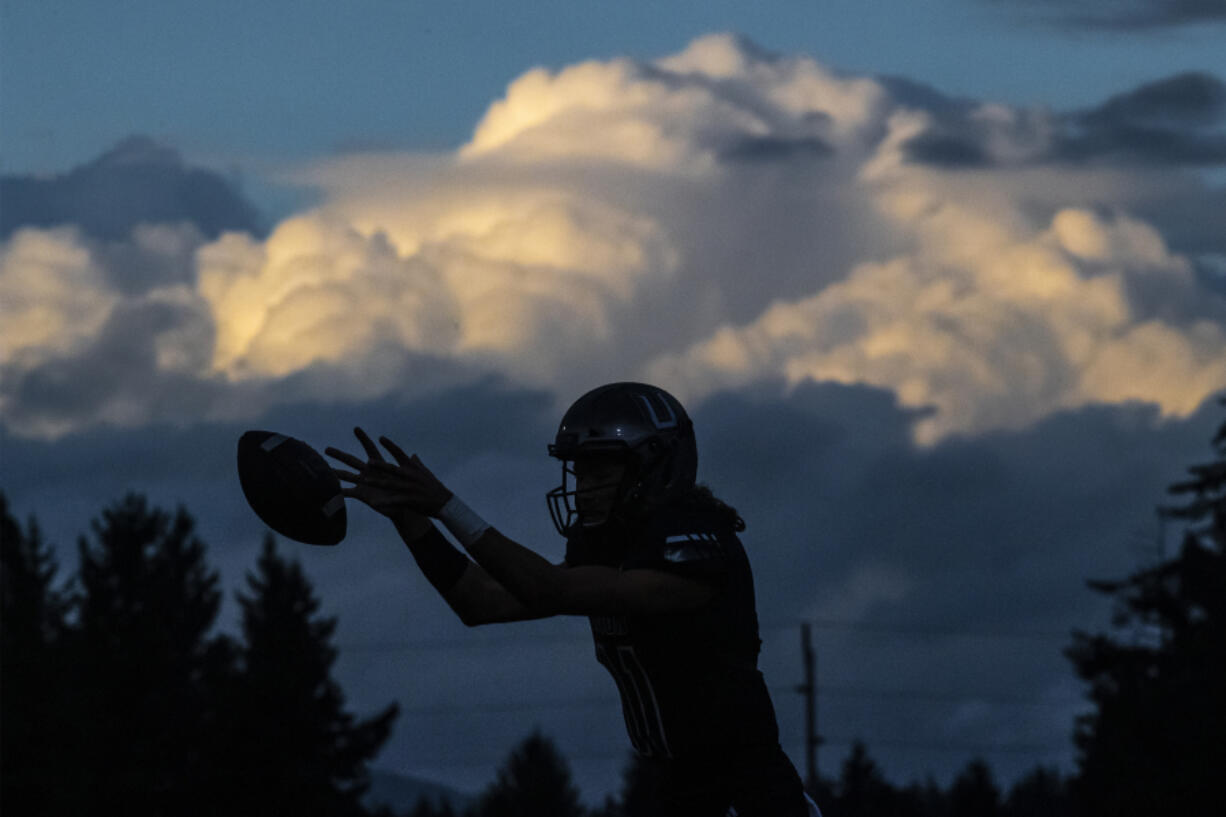 Union quarterback Alex Gehrmann catches the ball in a game against Chiawana at McKenzie Stadium on Friday night, Sept 27, 2019.