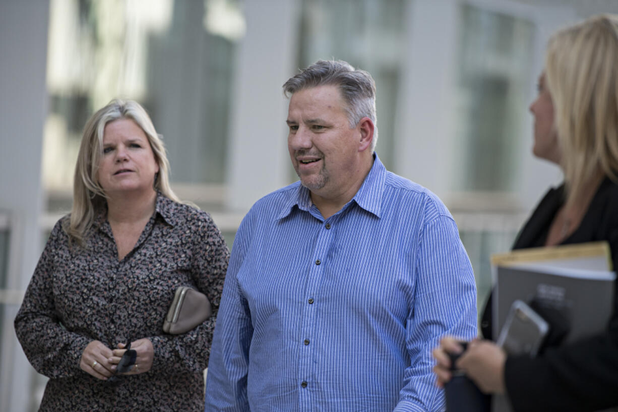 Michelle Bishop, from left, and her husband, former Vancouver pastor John Bishop, return to the courthouse for John Bishop's sentencing for unlawful importation of a controlled substance-marijuana after a recess at the James M. Carter and Judith N. Keep United States Courthouse in San Diego, Calif., on Sept. 21, 2018.