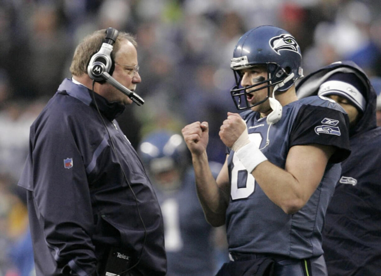 The Seattle Seahawks will honor former quarterback Matt Hasselbeck, right, on Oct. 25, 2021, and former head coach Mike Holmgren, left, on Oct. 31, 2021, as both will have their names added to the Seahawks Ring of Honor at Lumen Field in Seattle.