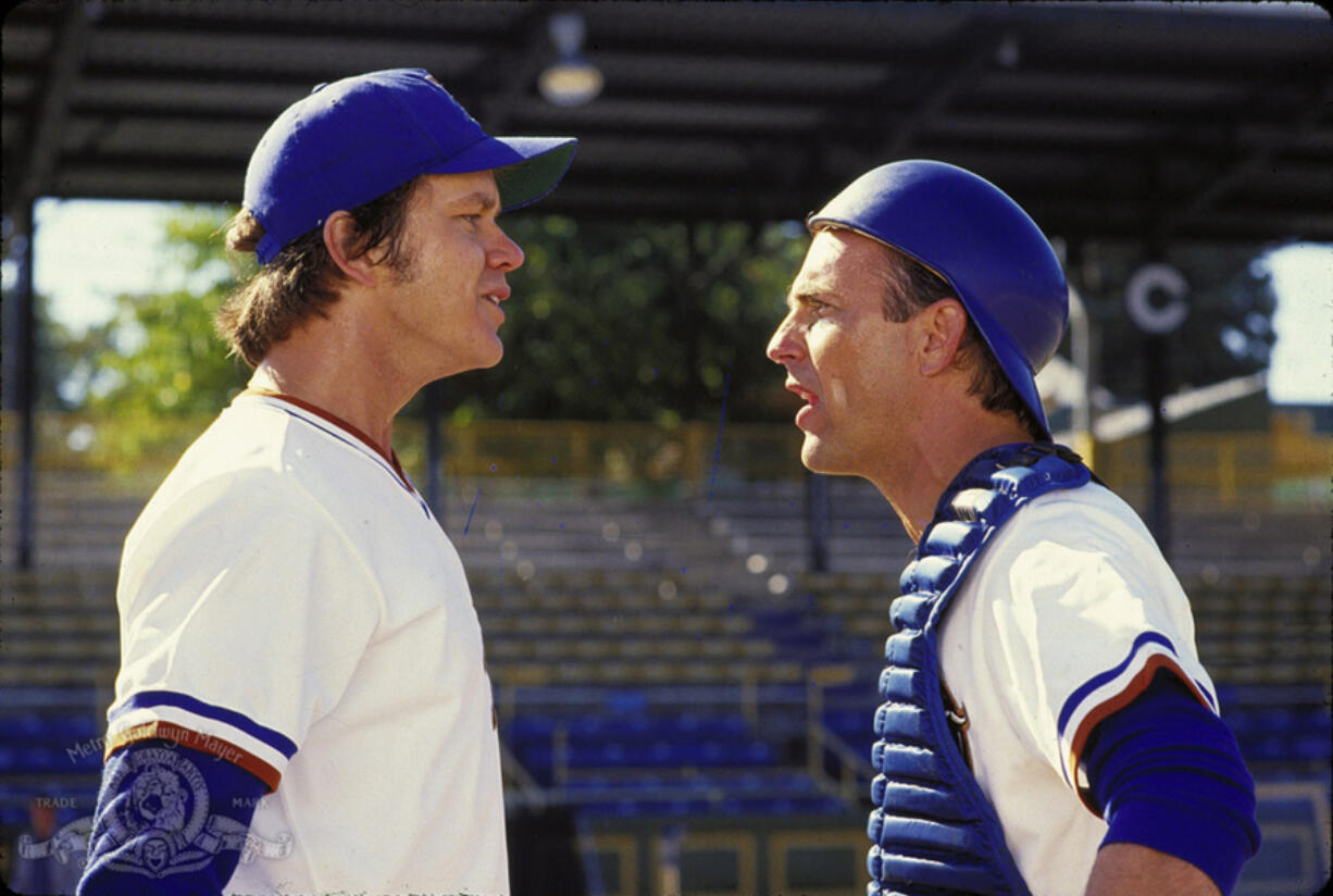 """Tim Robbins, left, and Kevin Costner in """"Bull Durham."""" (MGM)"""