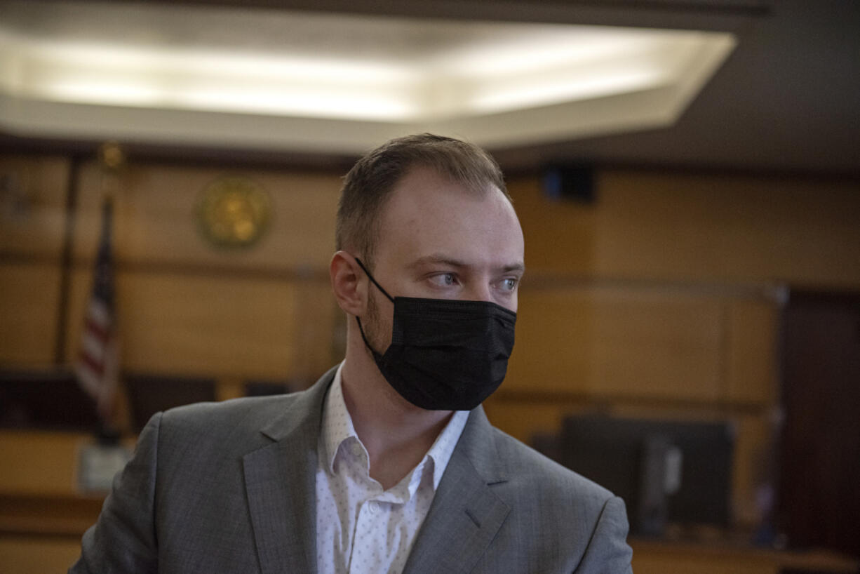 Defendant David Bogdanov awaits the verdict in his murder trial Thursday afternoon at the Clark County Courthouse. The Superior Court jury had not reached a verdict by the end of the day Thursday and will resume deliberations today.