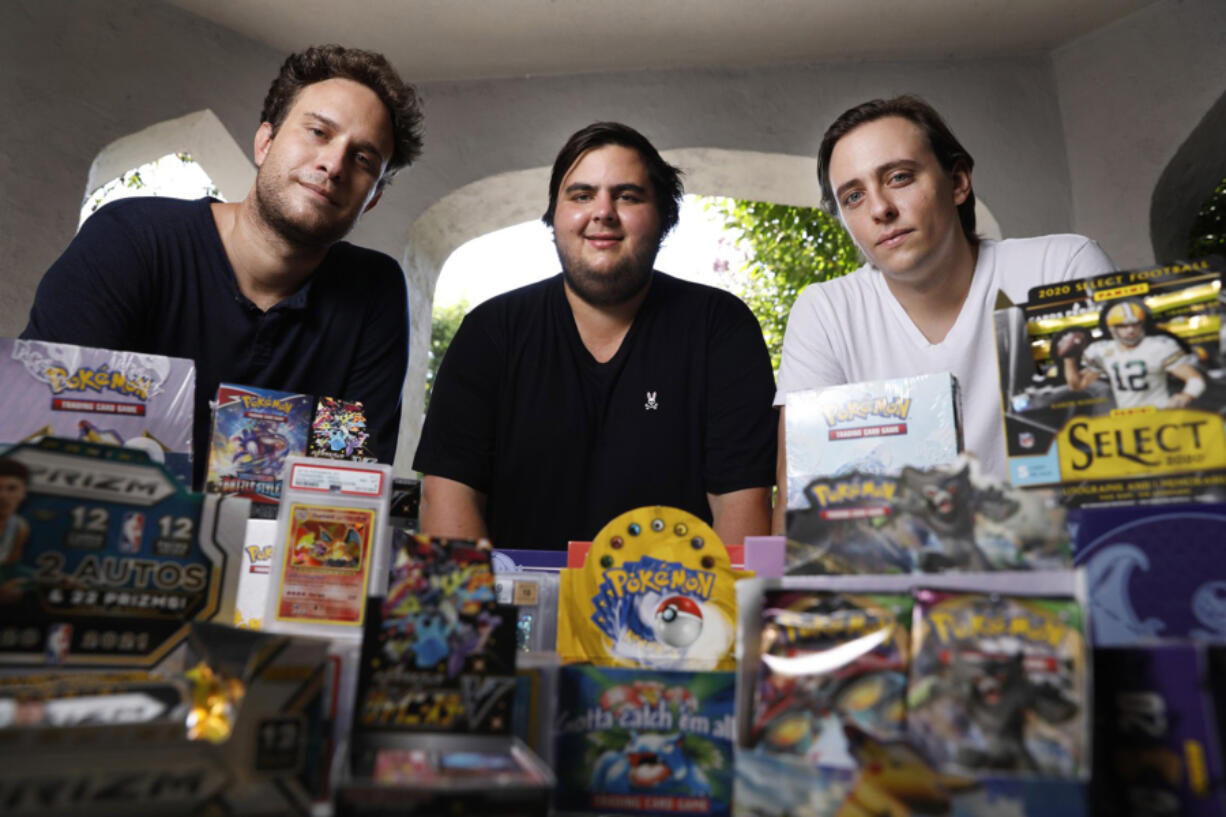 Anthony Jimenez, Michael Hotchkiss, and Gio Mancuso, from left, who run a live Instagram show selling and buying Pokemon collectibles, are photographed in Los Angeles on Friday, August 6, 2021.