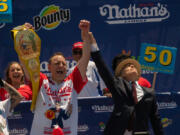 """Competitive eating champion Joey """"Jaws"""" Chestnut wins the 2021 Nathan's Famous 4th of July International Hot Dog Eating Contest with 76 hot dogs, breaking his personal best record of 75 at Coney Island on July 4 in New York City."""