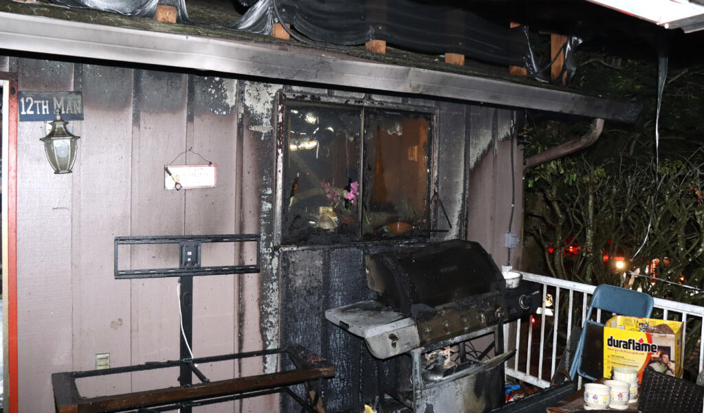 A propane grill fire destroyed a house in the Cascade Park area Monday night and displaced four residents.