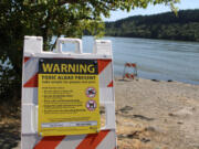 A toxic-algae warning sign is posted next to Lacamas Lake in Camas on July 20, 2020.