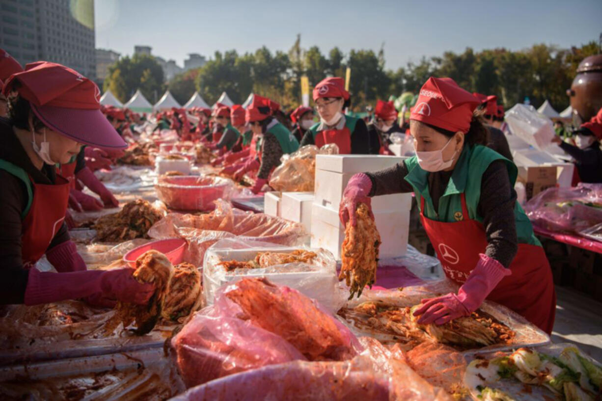 Volunteers take part in a kimchi-making festival in Seoul in 2018.