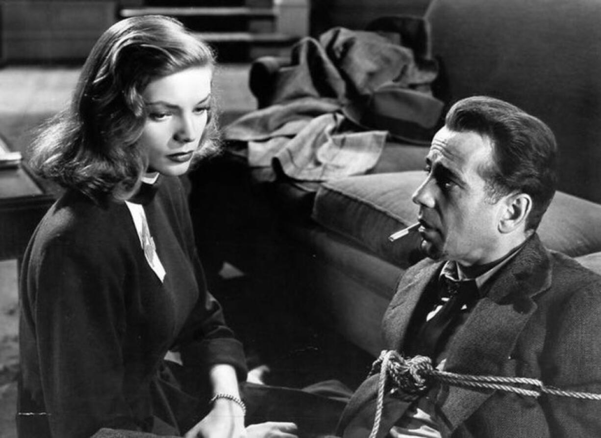 """There's never been snappier dialog -- and more onscreen electricity -- than between Humphrey Bogart and Lauren Bacall in 1946's """"The Big Sleep."""" (Warner Brothers Pictures)"""