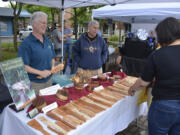 Visitors to the 2019 Washougal Art Festival browse the wares at a booth. This year's festival is Saturday in Reflection Plaza.