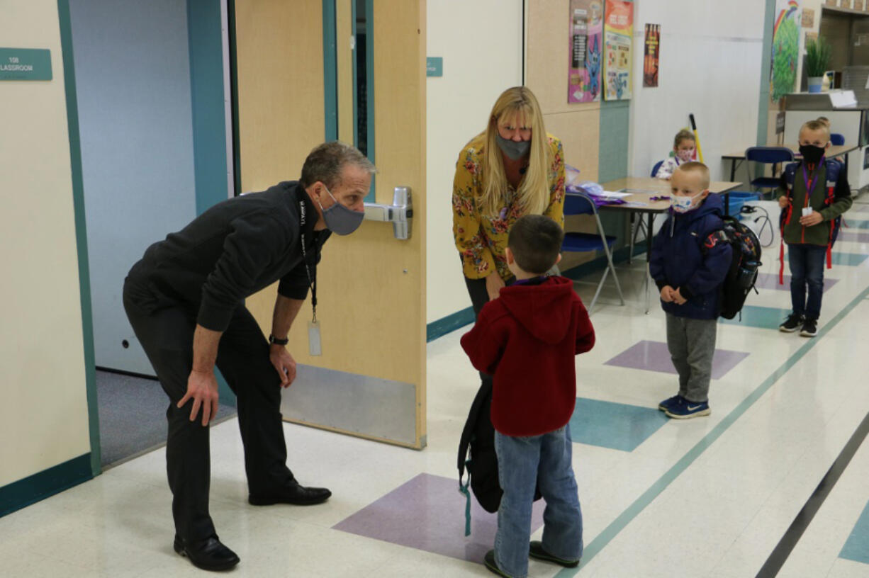 Battle Ground Deputy Superintendent Denny Waters chats with a kindergartner during the 2020-21 school year. Waters spent the past four years as the district's deputy superintendent before becoming superintendent July 1.