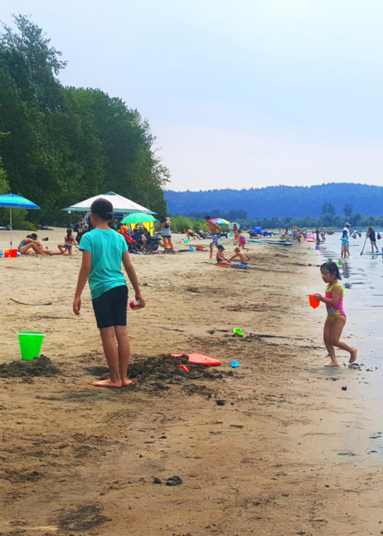 The relatively shallow water near the shores of Cottonwood Beach on the Columbia River offers fun summertime splashing. Even when it's crowded, you can find your spot.