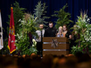 Family members of Sgt. Jeremy Brown including his wife, Jill Brown, at microphone, gather to honor his memory during his celebration of life at ilani casino Tuesday afternoon, Aug. 3, 2021. More than 2,500 people attended the standing room-only service.