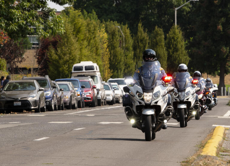 Officers on motorcycles start the procession preceding the funeral of Clark County Sheriff's Sgt. Jeremy Brown on Tuesday, Aug. 3, 2021, at Clark College. Brown was fatally shot on July 23 while conducting surveillance on a group of people at an east Vancouver apartment complex. Hundreds of law enforcement vehicles took place in the procession up I-5 to ilani casino in La Center. It took 15 minutes for the hundreds of vehicles to vacate the Clark College lot.