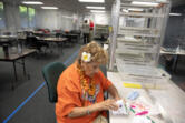 Elections office employee Josie Karling inspects ballots at the Clark County Elections Office on Tuesday morning.