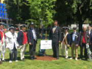 ESTHER SHORT: From left are Sons of the American Revolution members Larry Heckethorne; George Vernon; Larry Peck; Andrew Brewer; Paul Ocker; Carl Gray; Keith Weissinger, president; Alfred Folkerts; Greg Lucas, vice president; and Jeff Lightburn, president of the Fort Vancouver Chapter, at a tree planting earlier this year.