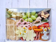 Charcuterie, including this elegant offering from Board and Bubbles, can elevate a picnic from fun to memorable.