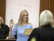 Abigail Bartlett, center, is sworn in as a District Court judge at the Clark County Courthouse on Thursday afternoon. She previously served as a District Court commissioner and takes over the seat previously held by Judge John Hagensen.