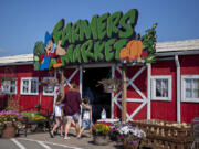 Shoppers at Bi-Zi Farms enter the farmers market to search for fresh produce. The farm has been in the Zimmerman family since 1872 and the Bi-Zi Farms retail operation has been going since 1985.