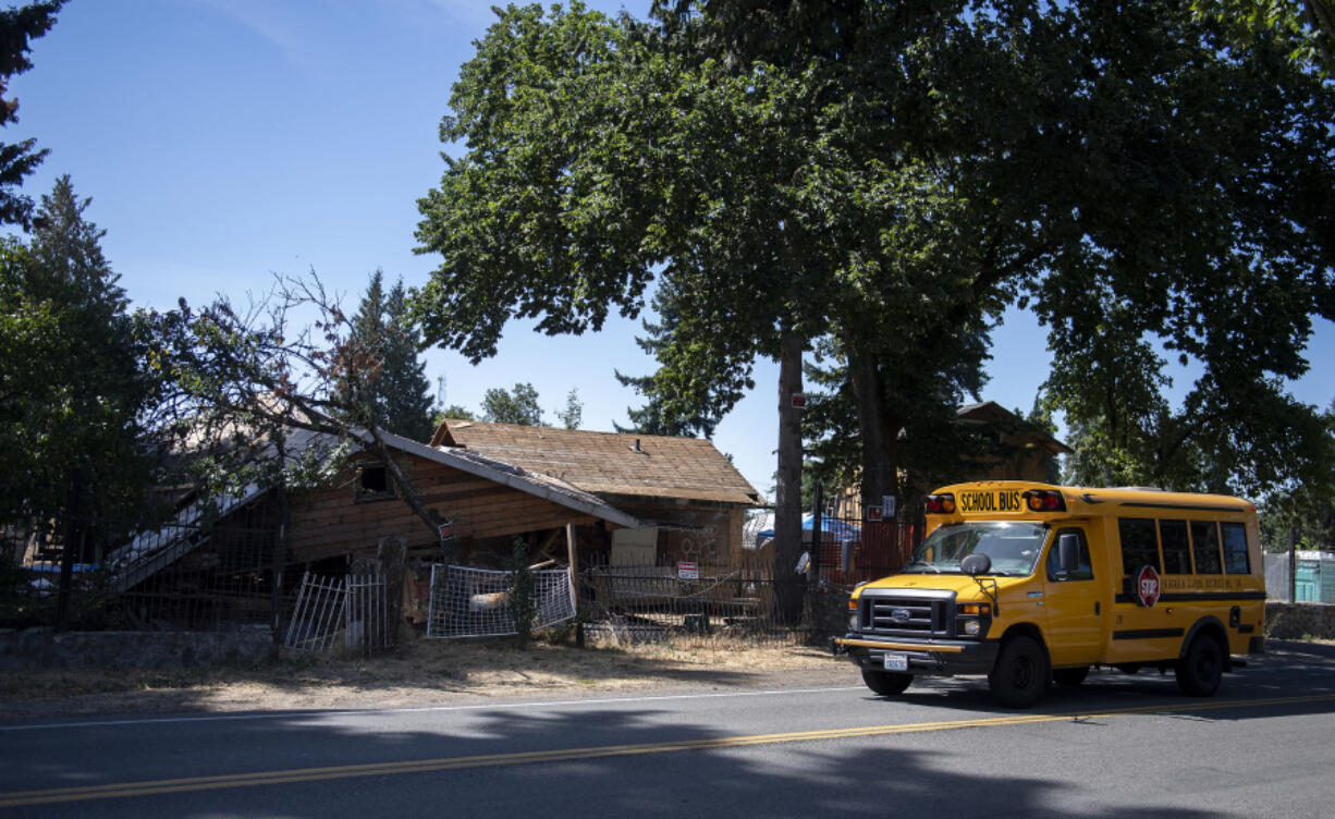 """The house at 6114 N.E. 112th Ave., dubbed the """"meth mansion,"""" is seen Tuesday morning partly demolished. Code violations and nuisance complaints over the property have plagued the neighborhood for years. Demolition is scheduled to be finished by Aug. 20."""