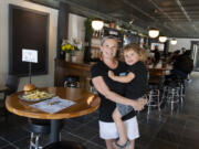 Mav's Taphouse owner Calista Crenshaw pauses for a portrait with her son, Maverick Britt in downtown Vancouver on Wednesday afternoon. The new taphouse is named in honor of Maverick.