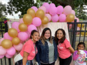ROSE VILLAGE: Ashley Jones, center, poses for a photo with Boys & Girls Clubs Washington Elementary Club employees Mikaela Bolds, left, and Maria Ramirez, right, and club member Rolynda, far right.