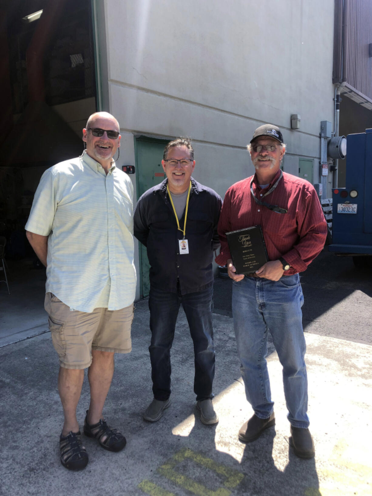 WOODLAND: Superintendent Michael Green, from left, and KWRL Director Shannon Barnett celebrate with Bob Lute, who retired this year after 42 years of service.