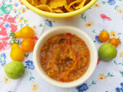The main ingredients in this salsa -- tomatillos and cherry tomatoes, plus cherry and bell peppers -- make this an approachably sweet and mellow condiment.