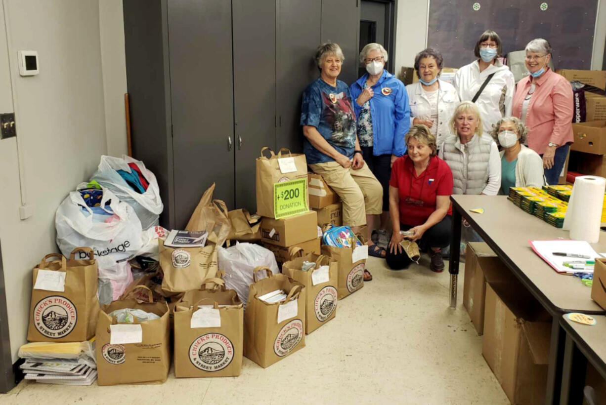 Boxes and bags of school supplies were taken to the Battle Ground Education Foundation office on the district's Lewisville campus by Greater Federation of Women's Club-Battle Ground members. Standing are: Ginger Crabtree, president Mary Lee Miller, Nancy Lee, Johanna Hyatt and Linda Tochen. In front are Marla Polos, Paulette Stinson and Valerie Huey. Not pictured was Cindi Pike, member photographer.