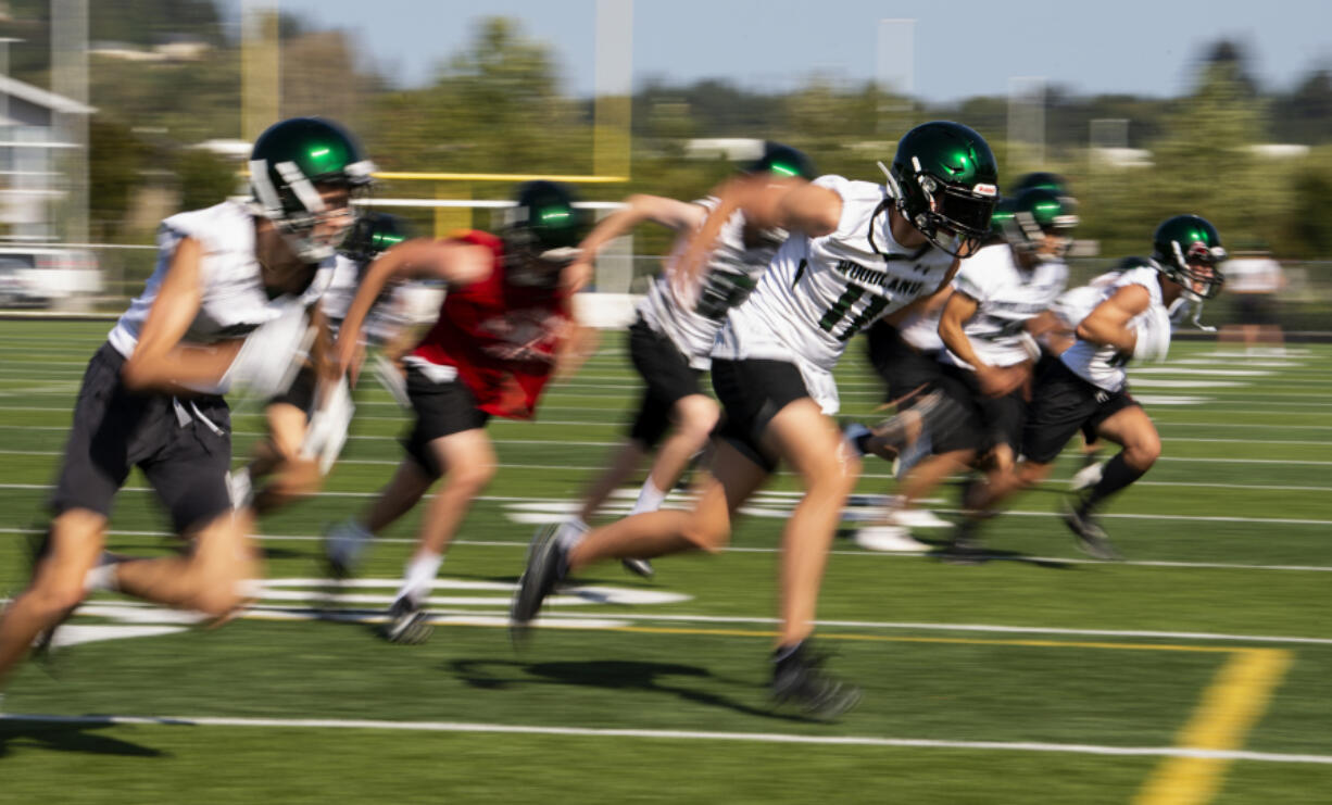 Woodland junior Justin Philpot sprints toward the sideline during a defensive back drill as high school football started its first fall season since 2019 on Wednesday, Aug. 18, 2021, at Woodland High School. Football practices resumed Wednesday for all Clark County teams with the first games just 16 days away.