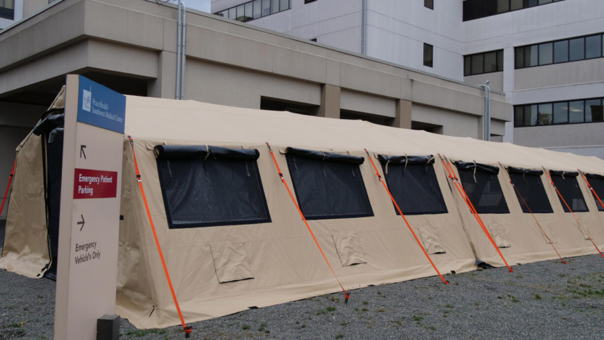 PeaceHealth Southwest Medical Center in Vancouver has erected a tent outside the entrance of its emergency department to serve as an overflow waiting area for patients seeking care.